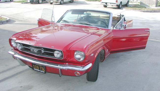 This Rangoon Red 1966 Ford Mustang GT convertible is as American as Apple
